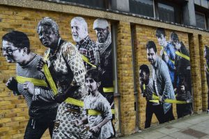 an image of 'We're All in the Same Boat', a community mural by Polish Street Artist Jola, commissioned by Essex Book Festival for their Meet the Neighbours Day in Harlow, March 2017