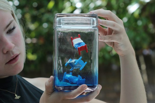 Image of girl looking at one of the Live Poetry Jukebox jars