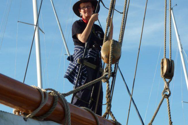 A picture of Claudia Myatt on board a board