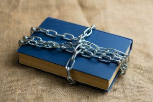 An image of a book with a chain around it