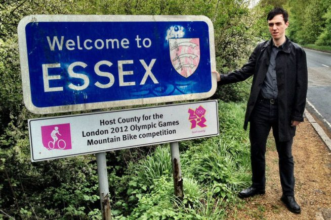 A picture of Tim Burrows next to the Essex county sign
