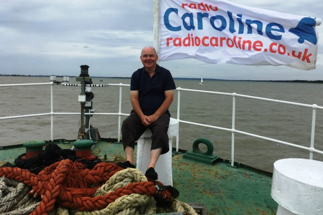 A picture of Ray Clark on the bough of the Radio Caroline ship