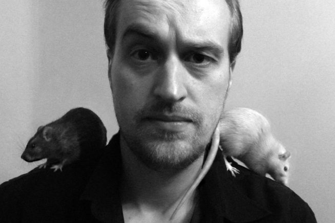 Image of graphic artist Carl Doherty with mice on his shoulders